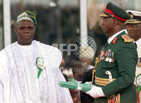 General Abdulsalam Abubakar handing over the reigns of office to Olusegun Obasanjo. May 29, 1999.